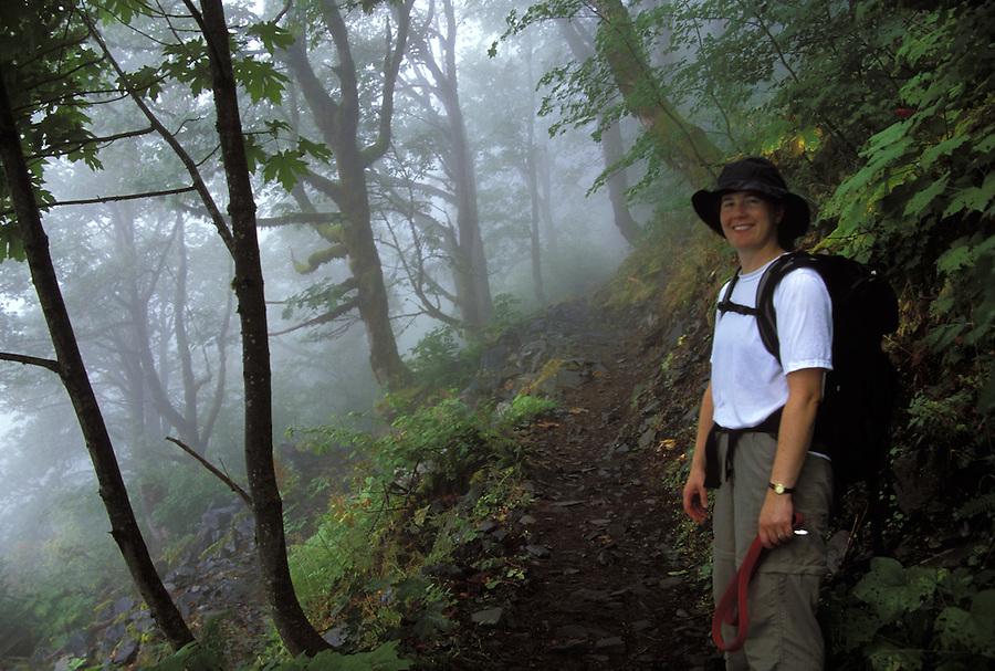 Woman hiking on trail, Lake 22 Trail, Cascade Mountains, Washington