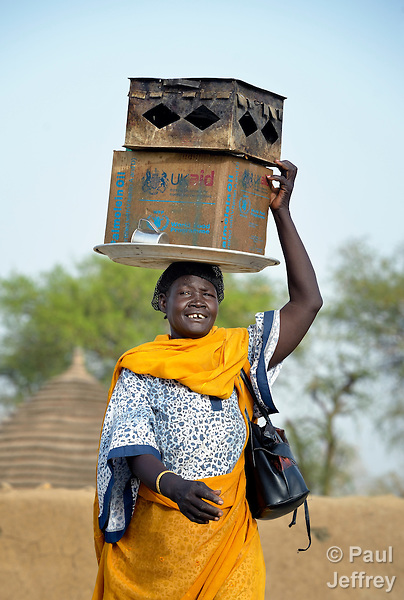 A displaced woman carries supplies on a tray on her head in Agok, a town in the contested Abyei region where tens of thousands of people fled in 2011 after an attack by soldiers and militias from the northern Republic of Sudan on most parts of Abyei. Although the 2005 Comprehensive Peace Agreement called for residents of Abyei--which sits on the border between Sudan and South Sudan--to hold a referendum on whether they wanted to align with the north or the newly independent South Sudan, the government in Khartoum and northern-backed Misseriya nomads, excluded from voting as they only live part of the year in Abyei, blocked the vote and attacked the majority Dinka Ngok population. The African Union has proposed a new peace plan, including a referendum to be held in October 2013, but it has been rejected by the Misseriya and Khartoum.