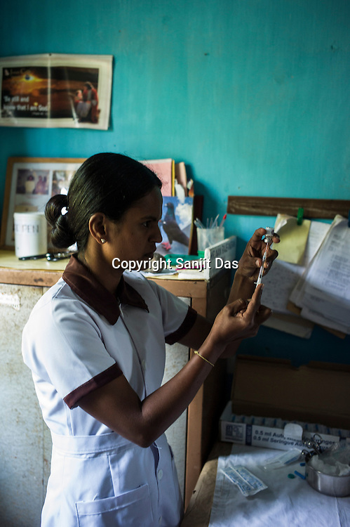 A nurse prepares to vaccinate children at the local health clinic in Eskdale Tea Estate in Nuwareliya in Central Sri Lanka.  Photo: Sanjit Das/Panos