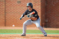 Richard Carter (10) of the Coastal Carolina Chanticleers lays down a bunt against the High Point Panthers at Willard Stadium on March 15, 2014 in High Point, North Carolina.  The Chanticleers defeated the Panthers 1-0 in the first game of a double-header.  (Brian Westerholt/Four Seam Images)