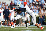 24 October 2015: Virginia's Quin Blanding (3) tackles UNC's Elijah Hood (34). The University of North Carolina Tar Heels hosted the University of Virginia Cavaliers at Kenan Memorial Stadium in Chapel Hill, North Carolina in a 2015 NCAA Division I College Football game. UNC won the game 26-13.