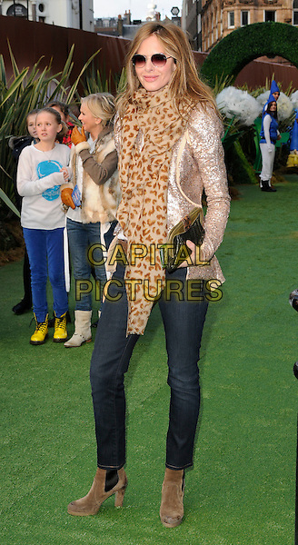 TRINNY WOODALL .Attending the 'Gnomeo And Juliet' UK film premiere, Odeon cinema, Leicester Square, London, England, UK,.30th January 2011..& arrivals full length beige brown leopard animal print scarf sunglasses jeans ankle boots grey gray gold sequined sequin jacket clutch bag .CAP/CAN.©Can Nguyen/Capital Pictures.