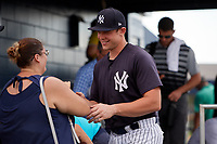 New York Yankees Josh Breaux (20) interacts with a fan during a Florida Instructional League game against the Pittsburgh Pirates on September 25, 2018 at Yankee Complex in Tampa, Florida.  (Mike Janes/Four Seam Images)