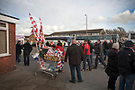 Fleetwood Town 1 Wrexham 1, 10/04/2012. Highbury Stadium, Football Conference Premier. Flags and scarves on sale by a seller using a shopping trolley before Fleetwood Town hosted Wrexham in a Blue Square Conference Premier match at Highbury Stadium. The match, between the top two teams in the division ended in a 1-1 draw watched by a near-capacity crowd of 4996. A victory for the hosts would have seen the club promoted to the Football League for the first time. Photo by Colin McPherson.