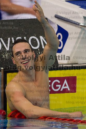Fabio Scozzoli of Italy celebrates his victory in the Men's 100m Breaststroke final of the 31th European Swimming Championships in Debrecen, Hungary on May 22, 2012. ATTILA VOLGYI