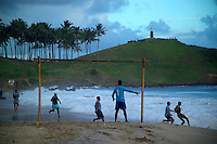 Salvador, Brazil, October 2004.  Football is the favourite sport of the people on the beach. The streets of Salvadors historical center are lined with colorful buildings from colonial times.  Photo by Frits Meyst/Adventure4ever.com