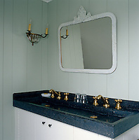 An aura of 18th century elegance pervades the grey and black bathroom