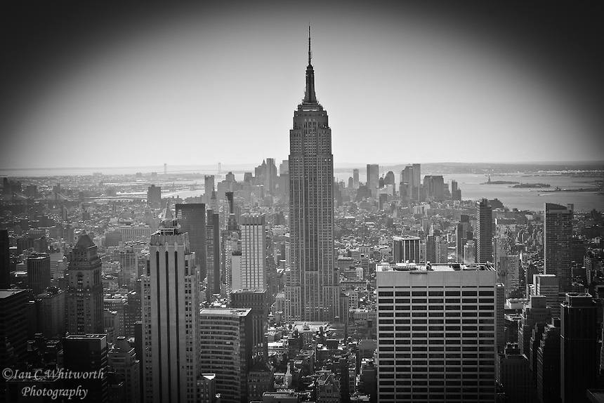 Peering out from the Top of the Rock at the New York City skyline in black and white