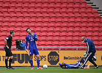 4th July 2020; Ashton Gate Stadium, Bristol, England; English Football League Championship Football, Bristol City versus Cardiff City; Leandro Bacuna of Cardiff City receives medical attention while Sean Morrison of Cardiff City shares a joke with Referee Tim Robinson