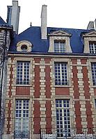 Paris: Place des Vosges. Restored upper story.