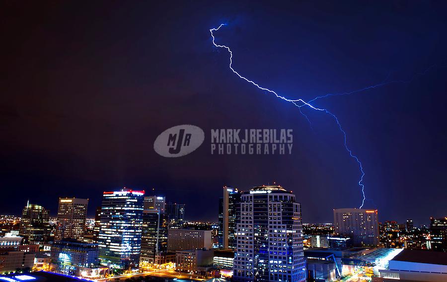 Lightning strike bolt thunderstorm monsoon storm thunderstorm downtown Phoenix Arizona city sky lights urban chaser chasing building skyscraper