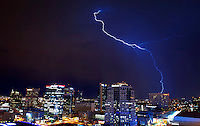 Lightning strike bolt thunderstorm monsoon storm thunderstorm downtown Phoenix Arizona city sky lights urban chaser chasing building skyscraper