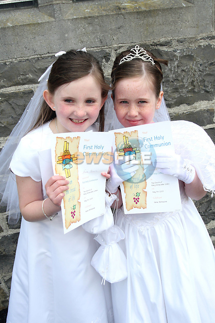 Áine Birch and Amy Carson after they made their Communion in Collon Church...Photo NEWSFILE/Jenny Matthews.(Photo credit should read Jenny Matthews/NEWSFILE)....This Picture has been sent you under the condtions enclosed by:.Newsfile Ltd..The Studio,.Millmount Abbey,.Drogheda,.Co Meath..Ireland..Tel: +353(0)41-9871240.Fax: +353(0)41-9871260.GSM: +353(0)86-2500958.email: pictures@newsfile.ie.www.newsfile.ie.FTP: 193.120.102.198.