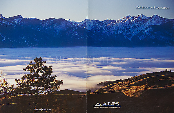 Nelson Kenter photo of fog in the Bitterroot Valley and the Bitterroot Mountain peaks on the west side of the valley used in an annual report, front and back cover