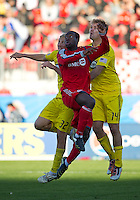 16 October 2010: Columbus Crew forward Steven Lenhart #32 and Columbus Crew defender Chad Marshall #14 battle with Toronto FC defender Nana Attakora #3  during a game between the Columbus Crew and Toronto FC at BMO Field in Toronto..The game ended in a 2-2 draw.