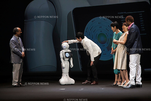 (L to R) Masayoshi Son chairman & CEO of SoftBank, robot Pepper, actor Koji Imada, actress Kanako Higuchi, announcer Kyoko Uchida and the actor Dante Carver attend a press conference to announce that the SoftBank's robot ''Pepper'' can feel as human on June 18, 2015, Tokyo, Japan. Masayoshi Son chairman & CEO of Japanese internet and telecommunications giant SoftBank Corp., announced that its robot Pepper can feel and understand people's emotions and also express itself. Son also said that the first 1000 robots will be on sale to the public for 198,000 JPY (1,604 USD) from Saturday June 20th, and could be available to companies to replace positions such as reception and convenience store staff from the beginning of July. To develop Pepper's skills SoftBank announced an alliance with foreign technology companies FOXCONN and Alibaba Group. (Photo by Rodrigo Reyes Marin/AFLO)
