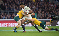 Twickenham, United Kingdom. Nathan HUGHES, holds off the defender's, during the Old Mutual Wealth Series Rest Match: England vs Australia, at the RFU Stadium, Twickenham, England, <br /> <br /> Saturday  03/12/2016<br /> <br /> [Mandatory Credit; Peter Spurrier/Intersport-images]