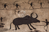"A wall painting depicting Wa people with their buffallo. Buffallo is one of the most adorable animal for Wa people. It symbolizes wealth. The Wa, which literally means ""mountain dwellers"", is the hilltribe that inhabit the Sino-Burmese. Known as one of the last headhunting tribe until mid-twentieth century, their population in both countries now approximately no more than one million. In the homogenous society of modern China, Wa is one of more than 50 officially state-recognized ethnic minorities. They can be found around the southwestern corners of Yunnan province."