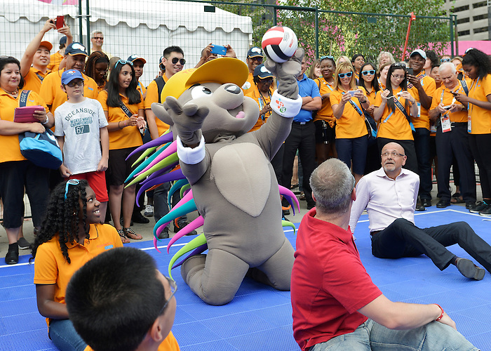 Toronto, ON - Aug 4 2015 - Toronto 2015 mascot Pachi, Toronto Mayor John Tory and Toronto 2015 CEO Saad Rafi take part in a Sitting Volleyball demonstration with volunteers at Nathan Phillips Square (Photo: Matthew Murnaghan/Canadian Paralympic Committee)