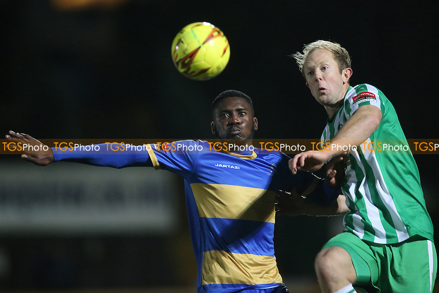 Chinedu McKenzie of Romford and Will Lawton of Soham during Romford vs Soham Town Rangers, Ryman League Division 1 North Football at Ship Lane on 3rd December 2016