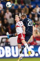 Dax McCarty (11) of the New York Red Bulls goes up for a header with Oriol Rosell (20) of Sporting Kansas City. Sporting Kansas City defeated the New York Red Bulls 1-0 during a Major League Soccer (MLS) match at Red Bull Arena in Harrison, NJ, on April 17, 2013.