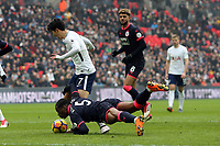 Son Heung-Min of Tottenham Hotspur is brought down in the penalty area by Terence Kongolo of Huddersfield Town but his appeals are waived away by referee Kevin Friend during Tottenham Hotspur vs Huddersfield Town, Premier League Football at Wembley Stadium on 3rd March 2018