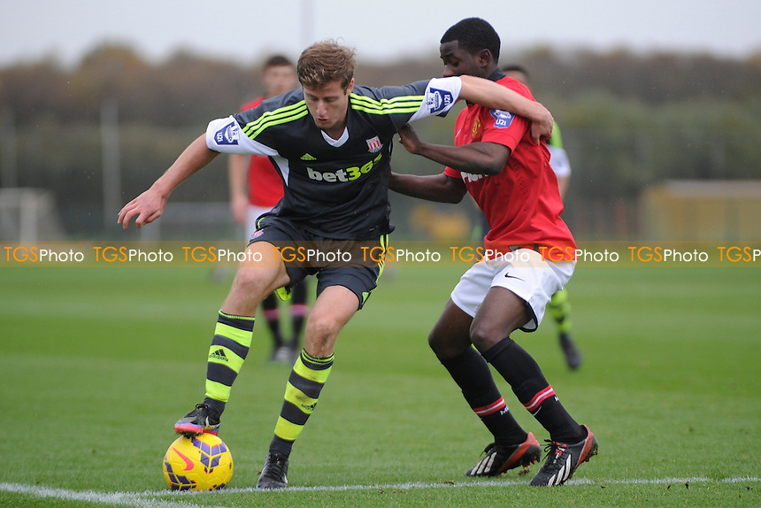 Elliot Wheeler of Stoke City holds up the ball from Larnell Cole of Manchester United - Manchester United Under-21 vs Stoke City Under-21 - Barclays Under-21 Premier League Football at the Aon Training Complex - 08/11/13 - MANDATORY CREDIT: Greig Bertram/TGSPHOTO - Self billing applies where appropriate - 0845 094 6026 - contact@tgsphoto.co.uk - NO UNPAID USE