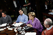 (L-R) British Prime Minister David Cameron, Russian Prime Minister Dmitry Medvedev, German Chancellor Angela Merkel, and European Council President Herman Van Rompuy participate in working session one during the 2012 G8 Summit at Camp David May 19, 2012 in Camp David, Maryland. Leaders of eight of the worlds largest economies meet over the weekend in an effort to keep the lingering European debt crisis from spinning out of control. .Credit: Luke Sharrett / The New York Times / Pool via CNP