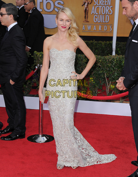 Naomi Watts (wearing Marchesa).Arrivals at the 19th Annual Screen Actors Guild Awards at the Shrine Auditorium in Los Angeles, California, USA..27th January 2013.SAG SAGs full length grey gray lace strapless dress silver clutch bag hand on hip.CAP/DVS.©DVS/Capital Pictures.