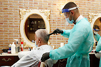 Barber shop <br /> Roma May 18th 2020. Covid-19 Italy further relaxes lockdown. Today a Council of Minister's decree will allow almost all the activity to reopen. Clothes shops, shopping centers, hairdresser and churches for religious services. <br /> Photo Samantha Zucchi Insidefoto