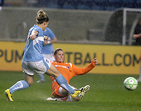 Sky Blue FC midfielder Jen Buczkowski (4) slide tackles the ball away from Chicago Red Stars forward Ella Masar (3).  The Chicago Red Stars tied Sky Blue FC 0-0 at Toyota Park in Bridgeview, IL on April 19, 2009.