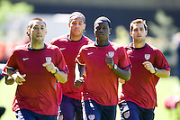 From left to right, Clint Dempsey, Oguchi Onyewu, Eddie Johnson, and Steve Cherundolo run training in Hamburg, Germany, for the 2006 World Cup, June, 6, 2006.