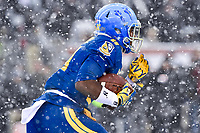 PHILADELPHIA, PA - DEC 9, 2017: Navy Midshipmen running back Garrett Winn (4) returns a kickoff during game between Army and Navy at Lincoln Financial Field Philadelphia, PA. Army defeated Navy 14-13 to win the Commander in Chief Cup. (Photo by Phil Peters/Media Images International)