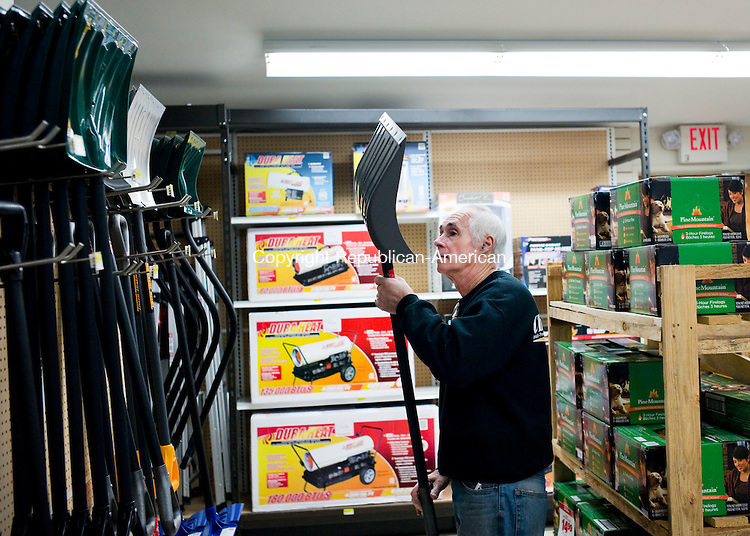 Southbury, CT- 28 December 2015-122815CM01- <br /> John Stack manager at Chatfield True Value Hardware organizes shovels at the store in Southbury on Monday.  Stack said customers were in the store purchasing ice melt and shovels ahead of the incoming winter weather.       Christopher Massa Republican-American
