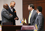 Nevada Sens., from left, Kelvin Atkinson, Aaron Ford, Michael Roberson and Ruben Kihuen talk on the Senate floor at the Legislative Building in Carson City, Nev., on Wednesday, April 15, 2015.<br /> Photo by Cathleen Allison