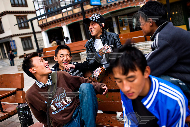 Youths hang around the city's main clock tower area in downtown Thimphu, Bhutan.