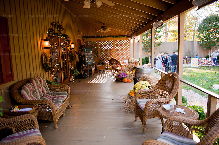 The front porch offers comfortable seating options, outside the tasting room at Keswick Vineyards.