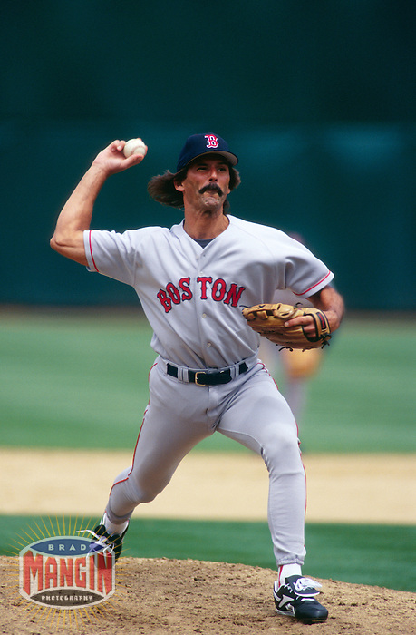 OAKLAND, CA - Dennis Eckersley of the Boston Red Sox pitches during a game against the Oakland Athletics at the Oakland Coliseum in Oakland, California on July 30, 1998. Photo by Brad Mangin.
