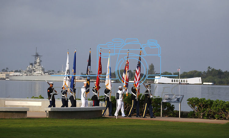 The color guard enters the 71st Anniversary Pearl Harbor Day Commemoration at the Pearl Harbor Visitor Center in Honolulu, HI on, Dec. 7, 2012. .Photo by Cathleen Allison
