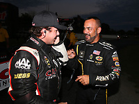 Sep 2, 2017; Clermont, IN, USA; NHRA top fuel driver Steve Torrence (left) and Tony Schumacher during qualifying for the US Nationals at Lucas Oil Raceway. Mandatory Credit: Mark J. Rebilas-USA TODAY Sports
