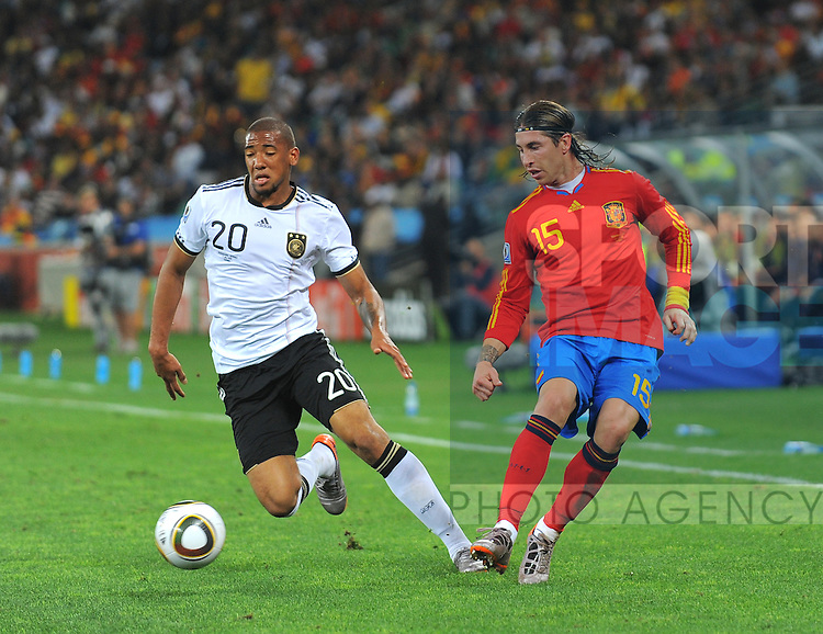 Sergio Ramos of Spain overlaps Jerome Boateng of Germany