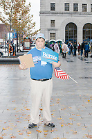 "Campaign volunteer Michael Sauce, of Concord, NH, gathers supporters' contact information after Democratic presidential candidate and Vermont senator Bernie Sanders spoke at a small rally outside the NH State House after he filed the required paperwork and paid the $1000 filing fee to be on the 2020 Democratic presidential ballot in the NH Secretary of State's Office in Concord, New Hampshire, on Thu., October 31, 2019. As part of the filing process, Sanders signed a ceremonial primary ballot that is signed by all candidates in the race. Sauce's Sanders campaign hat reads ""Bernie / Not Me US 2020."""