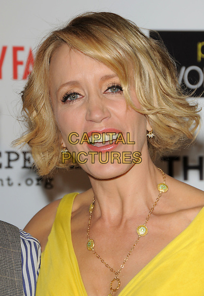 "FELICITY HUFFMAN .at The ThinkFilm Special Screening of ""Phoebe in Wonderland"" held at The WGA in Beverly Hills, California, USA, .March 1st 2009.                                                                     .portrait headshot  bright yellow gold necklace wavy hair bob .CAP/DVS.©Debbie VanStory/Capital Pictures"
