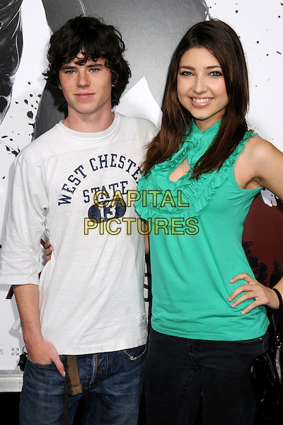 "CHARLIE McDERMOTT & SHELBY YOUNG.""Ninja Assassin"" Los Angeles Premiere held at Grauman's Chinese Theatre, Hollywood, California, USA..November 19th, 2009.half length white t-shirt green top ruffle.CAP/ADM/BP.©Byron Purvis/AdMedia/Capital Pictures."
