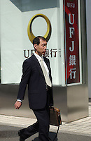 People pass in front of the UFJ bank in Tokyo  banking and business district called Otemachi..