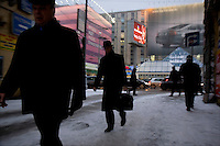 Pedestrians going to work on Tverskaya, the main street in Moscow, in front of Volvo billboard advertisment.. .Picture by Justin Jin.