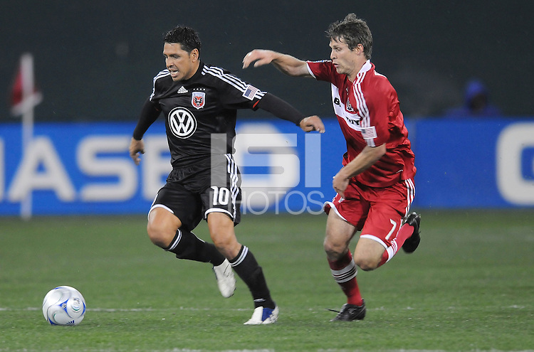DC United midfielder Christian Gomez (10) runs with the ball while being chased by Chicago Fire midfielder Logan Pause (7).  Chicago Fire tied DC United  1-1 at  RFK Stadium, Saturday March 28, 2009.