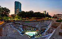 We capture this image of Fort Worth Water Gardens after sunset and their was still some light and color in the sky.  These wonderful water garden were built in 1974 for an urban oasis type of experience. The Water Garden are just around 4.3 and designed byarchitects Philip Johnson and John Burgee from New York. The Amon G. Carter foundation dedicated it to the city. The active pool experience was built for people to walk down the terraced steps and experience the power, sounds and motion of water crashing around them. On the day we were there I think everyone stopped for a visit. The Water Garden also feature the aerating pool with multiple illuminated spray fountains under a canopy of large oak trees.