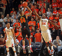 Jan. 27, 2011; Charlottesville, VA, USA; Maryland Terrapins guard/forward Cliff Tucker (24) shoots over Virginia Cavaliers guard K.T. Harrell (24) and Virginia Cavaliers guard Mustapha Farrakhan (2) during the game at the John Paul Jones Arena. Maryland won 66-42. Mandatory Credit: Andrew Shurtleff