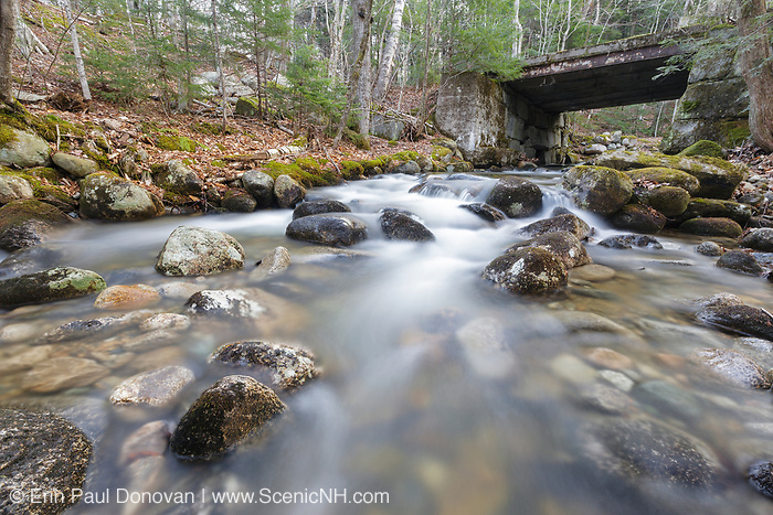 Looking upstream at an old bridge, which crosses Skookumchuck Brook, along the Notchway Trail. The Notchway Trail is the main trail of the Lafayette Ski Trails and follows the old Route 3 between Route 141 and Route 18 in the town of Franconia, New Hampshire.